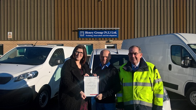 FTA's Jayne Currie presenting certificate to Colin Lumbar and Jim Henry from Henry Brothers.